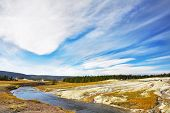 Flying clouds above meadows, woods  and river of the most well-known park in the world Yellowstone national park poster