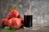 Glass Of Pomegranate Juice And Pomegranate Fruit On Grey Background. With Copy Space. poster