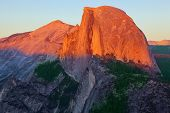 Sunset in national park Yosemite. The well-known top of mountain Half Doum poster