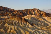 Precise mountain folds well-known a Zabrisky-point in Death valley in the USA. A sunset poster
