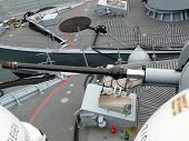 stock photo of labo  - portrait of gun on a german navy ship in ocean - JPG