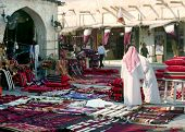 A view of Souq Waqif, Qatar, early in the morning, with flags flyiing in preparation for national day celebrations. poster