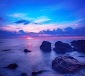 Beautiful Colorful Sunrise At The Sea With Dramatic Clouds And Boulders. Beauty World Natural Outdoo poster