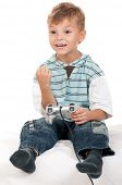 Happy little Boy Playing Video Games. Child using video game Controller. Kid with Joystick playing C poster