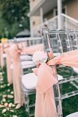 Square Wedding Ceremony. Transparent Chairs Are Decorated With Flowers, Greenery. Cute, Trendy Svdeb poster