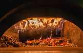 Wood Burns In Pizza Oven Close Up On Flames And Burning Embers poster