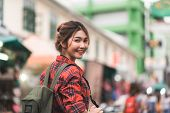 Traveler Backpacker Asian Woman Travel In Khao San Road At Bangkok, Thailand. Happy Young Female Spe poster