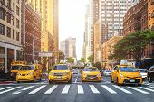 Yellow Cabs Waiting For Green Light On The Crossroad Of Streets Of New York City During Sunny Summer poster