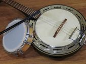 Two Brazilian Musical Instruments: Samba Banjo And Tamborim With Drumstick On A Wooden Surface. They poster