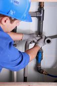 Plumber installing plastic domestic water pipes poster