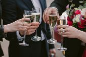 Celebration. Hands Holding The Glasses Of Champagne And Wine Making A Toast. The Party, Wedding, Cel poster