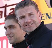 MOSCOW - FEBRUARY 23: Racing drivers Vitaly Petrov (L) and David Coulthard (R) during the 21st tradi