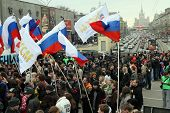 MOSCOW - MARCH 31: Youth hold flags during â??Generation Against Terrorâ? anti-terror demonstration