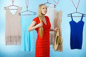 Woman In Clothes Shop Store Picking Summer Perfect Outfit, Holding Big Hat, Dress Hanging On Clothin poster