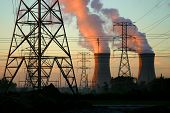 foto of nuclear disaster  - Power Plant cooling towers and power lines at sun rise - JPG