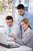 stock photo of business-partner  - Small group of young businesspeople working together in office - JPG