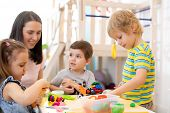 Kids Learning To Work Colorful Play Dough In Nursery, Kindergarten Or Day Care Center poster