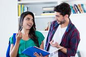Latin American Girl Learning With Spanish Male Student At Classroom Of University poster