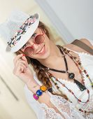 Portrait Of Beautiful Hippie Girl With A White Summer Hat poster