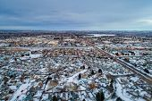 winter dusk over city - aerial view of residential and shopping areas of Fort Collins in northern Co poster