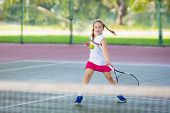 Child Playing Tennis On Indoor Court. Little Boy With Tennis Racket And Ball In Sport Club. Active E poster