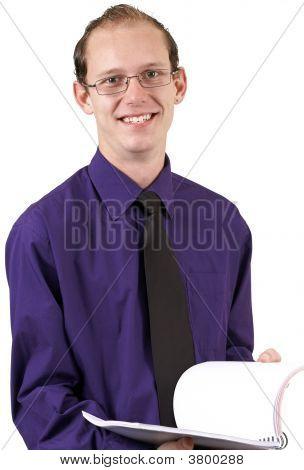 Businessman Paging Through A Book