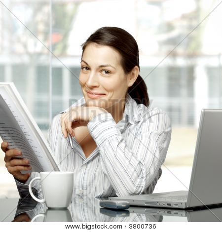 Businesswoman Reads Document