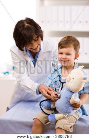 Doctor Examining Child