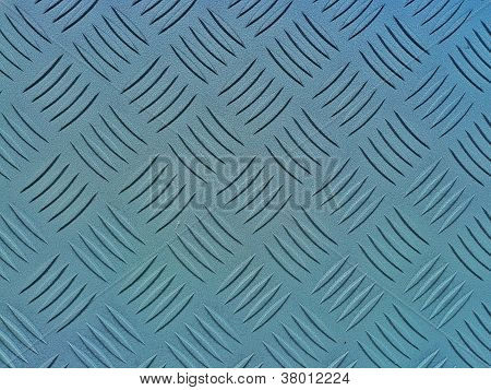 Industrial floor, featuring a diamond relief pattern,
