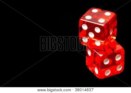 Two Red Dice On Black Background