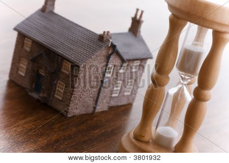 Hourglass And House Real Estate Concept