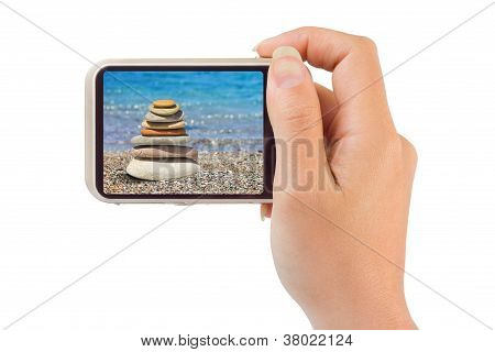 Camera With Beach Picture In Hand