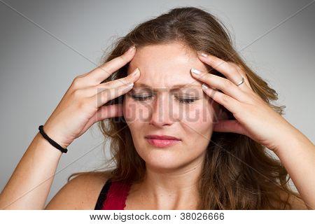 Blond Woman Having A Headache
