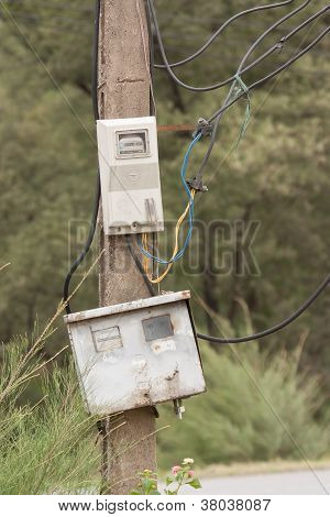 Cabinet With Electrical Meter On A Concrete Pole