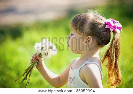 little girl closeup portrait with dandelion