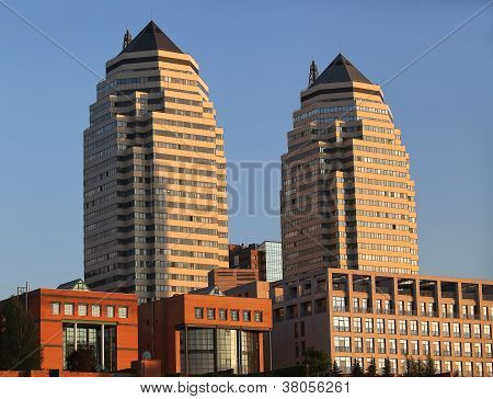 Two Tall Buildings At Sunset