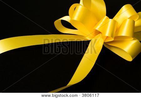Yellow Ribbon On Black Background