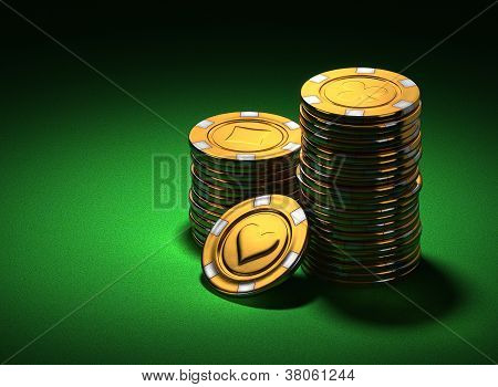 Small Group Of Gold Poker Chips On Green