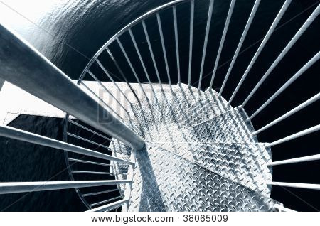 Looking Down A Metal Spiral Staircase
