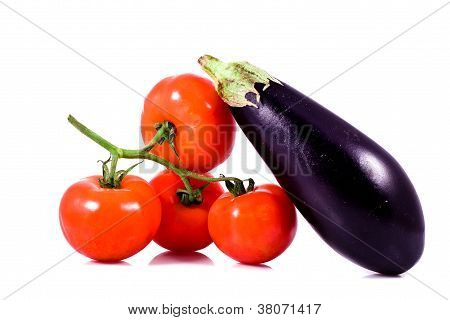 Fresh Red Tomatoes On Bunch And Eggplant