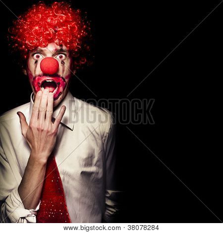 Surprised Clown Isolated Over A Black Background