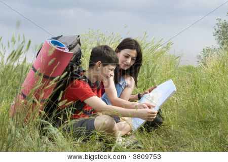 Hikers With The Map