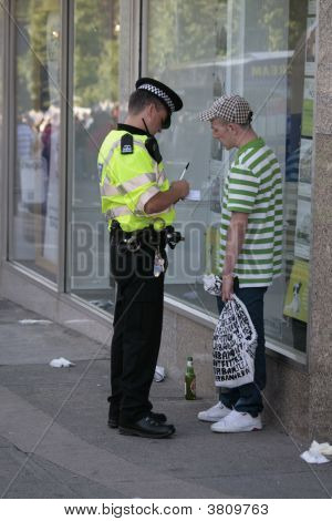 Policeman Questioning Youth