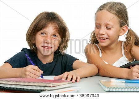 Boy And Girl At Homework Desk.