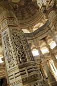 stock photo of jainism  - Detail on a pillar at Chaumukha Mandir the main jain temple at Ranakpur India - JPG