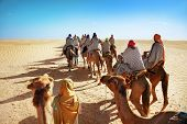 stock photo of nomads  - Landscape with people in the Sahara desert - JPG