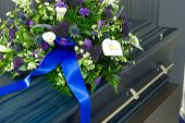 image of crematory  - A blue coffin in a morgue with a flower arrangement - JPG