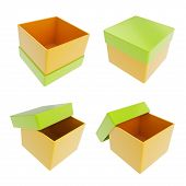 pic of parallelogram  - Set of four parallelogram cube shaped glossy orange and green colored gift boxes isolated on white background - JPG