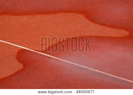 Traces Of Water On Red Plastic Runway