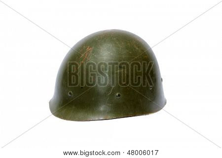 A genuine Vintage WWII (world war two) Army Helmet isolated on white. The perfect image for all your WWII image needs